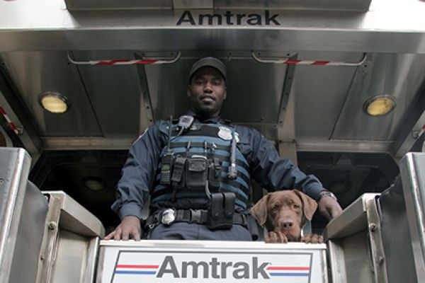 APD K-9 Officer at back of train